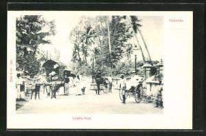 AK Colombo, Colpetty Road, Strassenpartie mit Rikschas