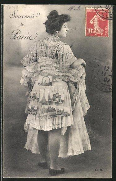 AK hübsche Pariserin mit klebenden Ansichtskarten auf dem Rock