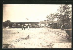 Foto-AK Dakar, Partie in einem Lager mit Lastkraftwagen 1918