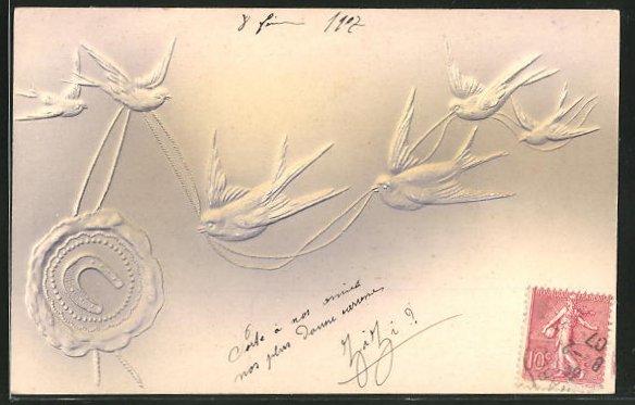 Präge-AK Schwalben im Flug mit einem Hufeisen-Siegel