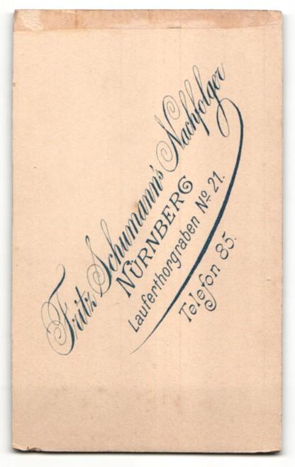 Fotografie Fritz Schumann's Nachf., Nürnberg, Portrait charmant blickender Soldat mit Schirmmütze in Uniform 1