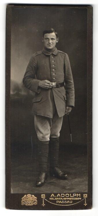 Fotografie A. Adolph, Passau, Portrait lächelnder Soldat mit Zigarette in interessanter Uniform 0