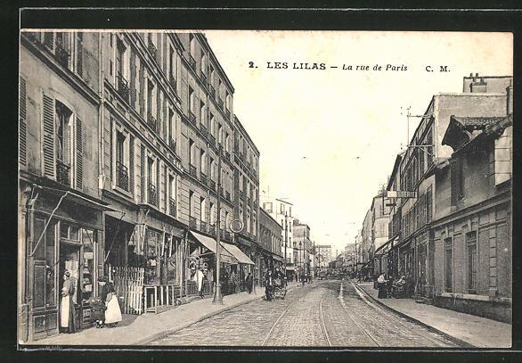 AK Les Lilas, La Rue de Paris, Strassenpartie mit Geschäften