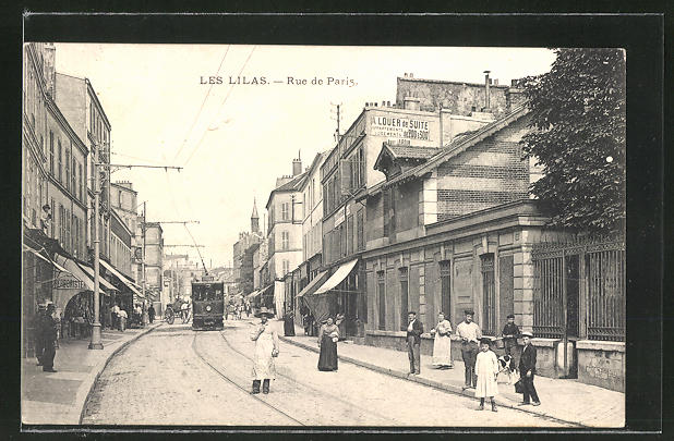 AK Les Lilas, Rue de Paris, Strassenbahn