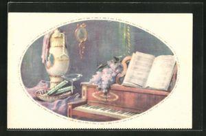 Künstler-AK Reklame für Tobler Schokolade, Schale mit Schokolade am Klavier