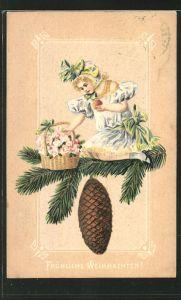 Präge-AK Mädchen mit Blumenkorb sitzt auf einem Tannenzweig, Fröhliche Weihnachten