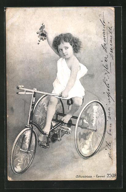 AK Mädchen mit Trauben auf einem Dreirad