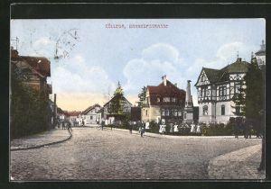 AK Cölleda, Bahnhofstrasse mit Passanten