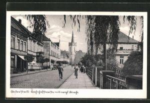 AK Duderstadt, Bahnhofstrasse mit Passanten