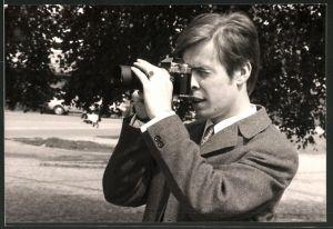 Fotografie Fotograf mit Fotoapparat bei der Arbeit
