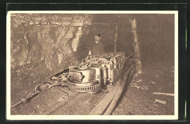 AK Arbeiter in der Kohlenzeche an der Pressluft-Stangenschrämmaschine der DEMAG, Duisburg