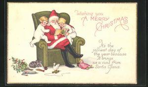 AK Weihnachtsmann sitzt im Sessel und liest den Kindern eine Geschichte vor