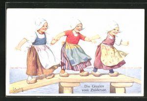 Künstler-AK Karl Feiertag: Drei Mädchen mit Schürzen und Holzschuhen am Steg