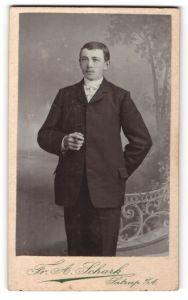 Fotografie Fr. A. Schark, Satrup i/A, Portrait junger Herr in Anzug