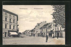 AK Gumbinnen, Wilhelmstrasse mit Geschäften