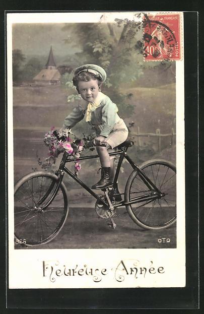 AK Kleiner Junge mit Blumen auf einem Fahrrad, Neujahrsgruss