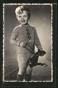 AK Lachender Bub auf seinem Steckenpferd