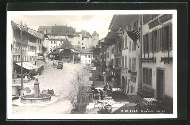 AK Gruyères, La Rue, Strassenpartie im Zentrum