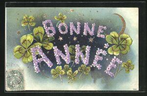 Präge-AK Bonne Annee, Neujahrsgruss mit Blumen und Klee