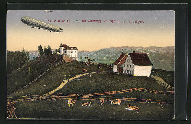 AK St. Anton, Ortsansicht mit Voralbergen u. Zeppelin in der Luft
