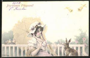 Künstler-AK Wichera: Dame mit Hut und Schirm auf einer Bank mit einem Hasen, Ostergruss