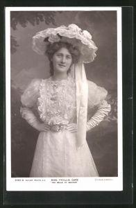AK Schauspielerin Miss Phyllis Dare mit Hut u. in die Hüften gestemmten Händen, The Belle of Mayfair