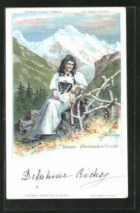 Künstler-AK C. Steinmann: Frau in Berner Oberländer-Tracht sitzt auf einem Felsen
