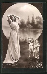 Foto-AK Atelier Reutlinger, Paris: hübsches Fräulein und zwei Mädchen mit Blumen