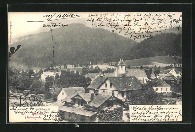 AK Kapellen, Teilansicht mit Kirchturm und bergiger Landschaft
