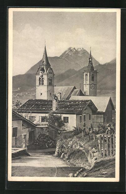 AK Schwaz, Kirche mit Gebirge im Hintergrund