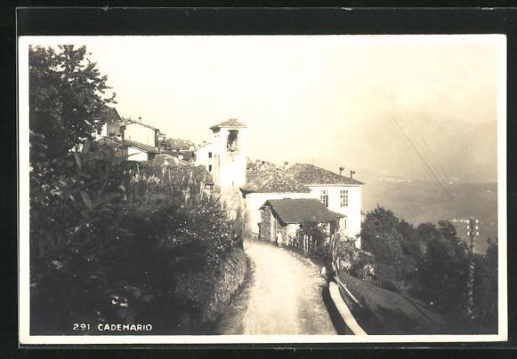 AK Cademario, Teilansicht mit Strasse zum Ort