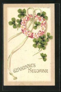Präge-Lithographie Glückliches Neujahr, Blütenkranz und Klee