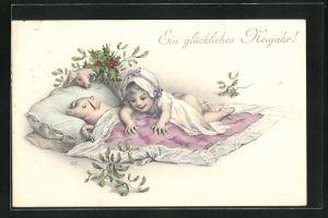 AK Ein glückliches Neujahr!, Kleinkind mit Schweinen im Bett