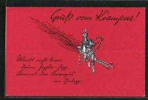 AK Krampus sitzt auf einer Rute und rasselt mit seiner Kette