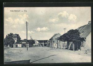 AK Veltrusy n. Vlt., Ortspartie mit Wohnhäusern und Geschäft