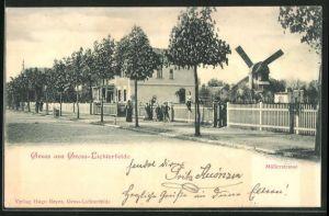 AK Berlin-Lichterfelde, Müllerstrasse mit Windmühle und Gebäudeansicht