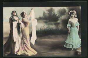 Foto-AK Atelier Reutlinger, Paris: drei bezaubernd schöne Frauen in elegnaten Kleidern am Flussufer