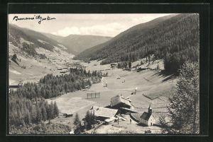 AK Innervillgraten, Ortsansicht mit Kirche und Wäldern von Anhöhe aus
