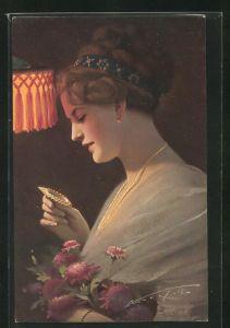 Künstler-AK Ludwig Knoefel: Hübsche junge Frau betrachtet ein Amulett
