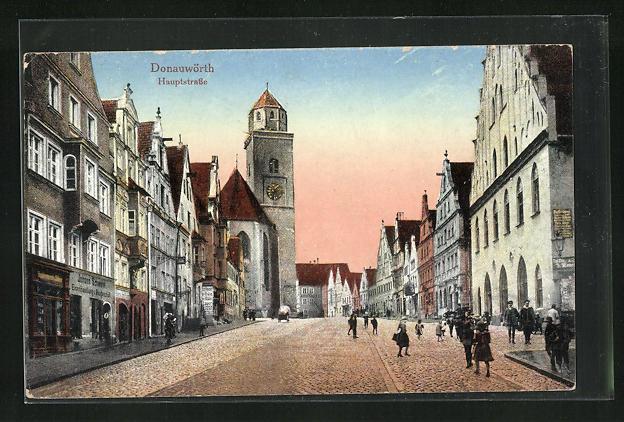 AK Donauwörth, Hauptstrasse mit Eisenhandlung und Geschäften, Kirchturm