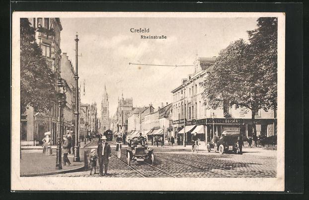 AK Crefeld, Rheinstrasse mit Blick auf Kirche, Geschäftsfassaden