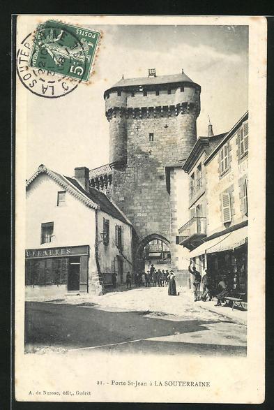 AK La Souterraine, Porte St-Jean, Strassenpartie am Stadttor