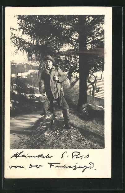 Foto-AK Jäger mit Gewehr und Beute