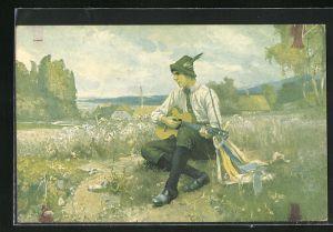 Künstler-AK Wandervogel, Wanderer mit Gitarre auf der Wiese