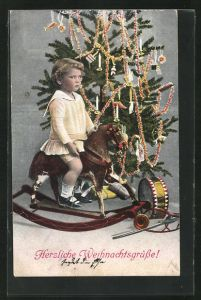 AK Mädchen auf einem Schaukelpferd unterm Weihnachtsbaum