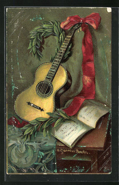 AK Gitarre mit rotem Band neben dem Notenbuch