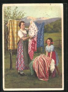 AK Reklame für mit Indanthren gefärbte Stoffe, Frau und Mädchen hängen Wäsche auf Leine, Gebirge