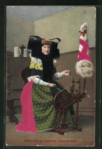 Stoff-Präge-AK Frau in Tracht aus Schaumburg-Lippe am Spinnrad