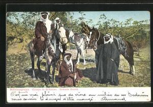 AK Beduinengruppe macht Rast mit ihren Pferden, arabischer Soldat