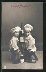 AK Junge u. Mädchen als Köche mit Sektflasche, Neujahrsgruss